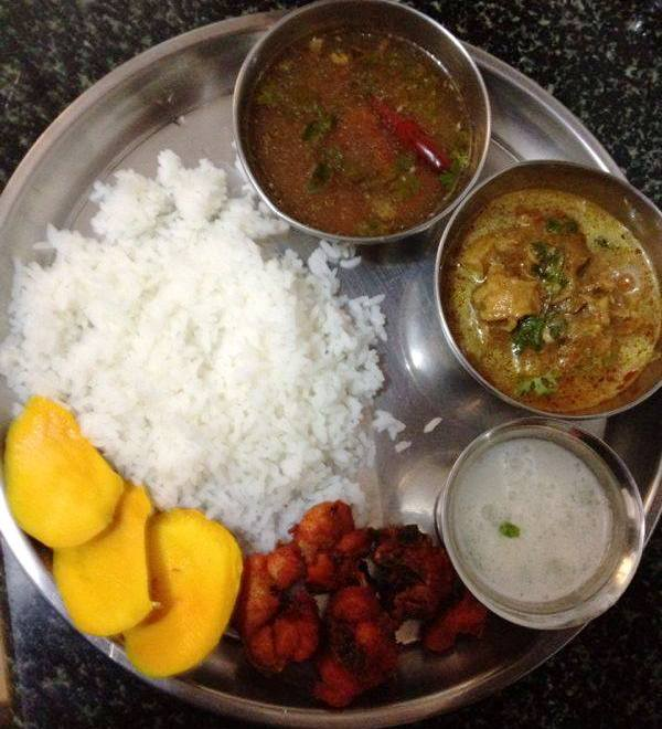 Kongu chicken curry served hot with rice, rasam, fried chicken and butter milk.