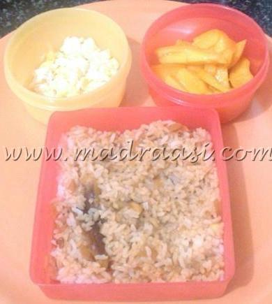 Rice with Karakuzhambu, scrambled egg and mangoes.