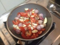 Onions, tomatoes and garlic getting fried