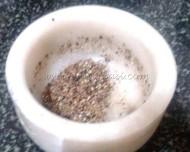 Crushed peppercorns and cumin seeds