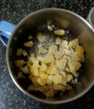Sesame, jaggery and cardamom powder about to pulse