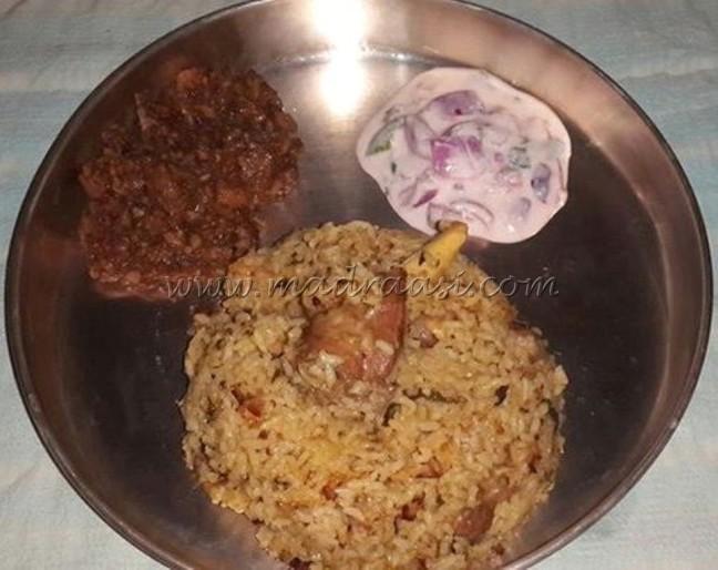Dindukkal thalapakkati briyani served with mutton chukka and raita