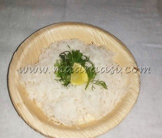 Rice noodles iwth coriander leaves and a lemon wedge