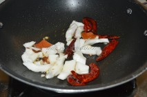 Coconut and red chilies getting roasted in oil