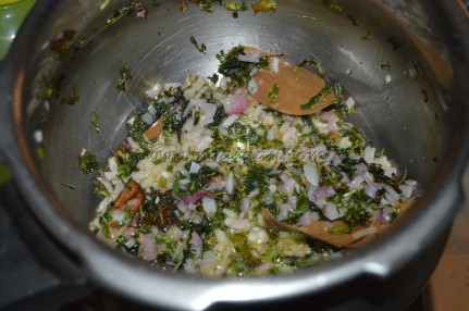With spices, onion, green chili, coriander & mint leaves and ginger-garlic paste