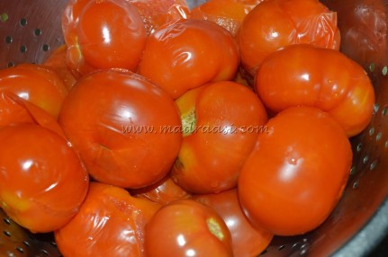 Tomatoes skin getting peeled in hot water