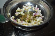 Onions and herbs getting sauted in olive oil