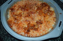 Brushed with tomato sauce and then sprinkled with sauted onions