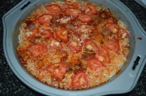Layered with sliced tomatoes