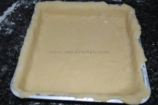 Flatten dough over the tray, about to bake