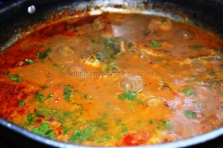 with coriander eaves and oil floating on the top of the curry