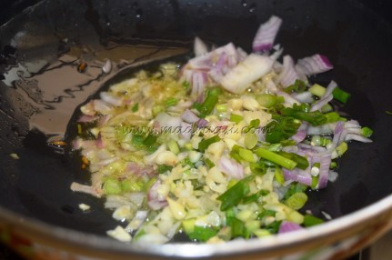 Onion, garlic and spring onions getting sauted