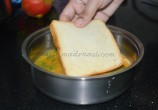 Bread getting dipped in the egg mixture