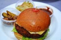 Chicken Burger with potato wedges, salad and dip