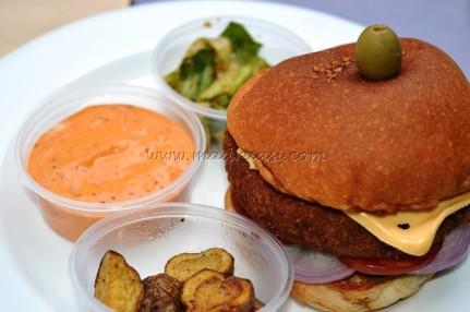 Veg Burger with potato wedges, salad and dip