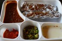 Parathas with salad, pickle, raita and a gravy