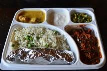 Tawa paratha, Peas Pulav, Bhindi masala, Khadi pakoda, salad and raita