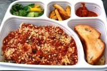 Mushroom Ravioli in tomato concasse meal with fries