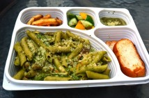 Pasta in creamy pesto and chicken meal served with fries, salad and garlic bread