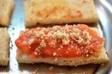 tasted bread layered with banana and sprinkled with ground nuts mixture