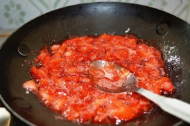 Strawberry getting cooked with sugar
