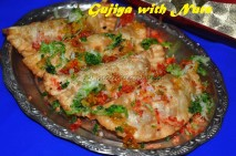 Gujiya with colored coconut gratings