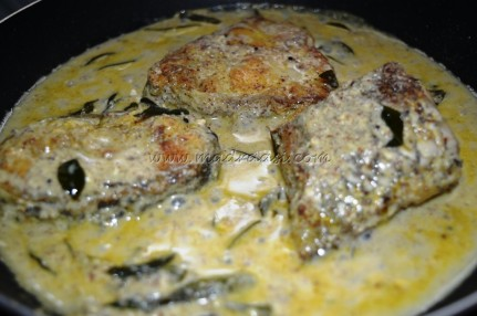 Mustard fried fish getting cooked in mustard gravy