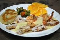 Seafood with mashed potato, fruits and veggies