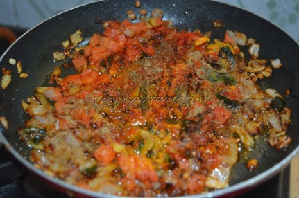 With tomatoes and spice powders