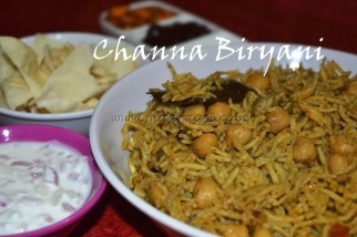 Channa / Chole Biryani served with raita, pappad, mango pickle and apple cinnamon preserve
