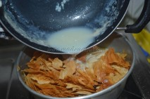 Pouring milk to filo sheets