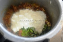 With yogurt/curd, coriander+mint leaves and fried onions