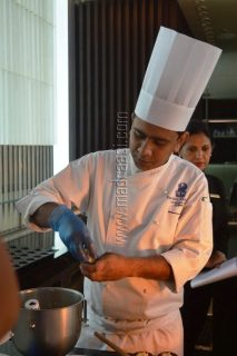 Chef demonstrating Apricot Cranberry Cupcake