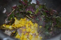 With spinach and corn