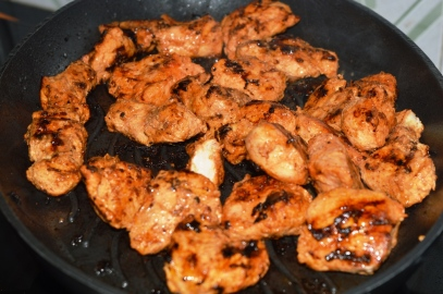 Marinated chicken getting grilled