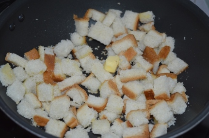 Bread cubes getting toasted in butter