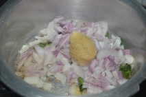 With finely chopped onions and curry leaves